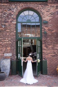 Bride entering the double doors at Biltmore Domicile