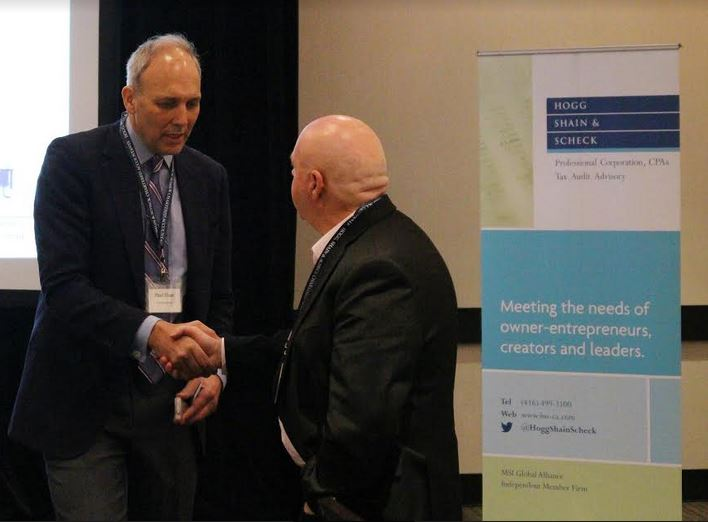 Paul Hunt shaking hands at the latest Managing For Growth Seminar