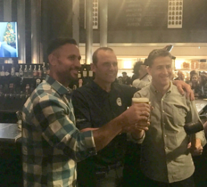 PJ L'Heureux (on right) founder and owner of Craft Beer Market with Peter Bulut Jr., (center) President and Chief Brewing Officer of Great Lakes Brewery.